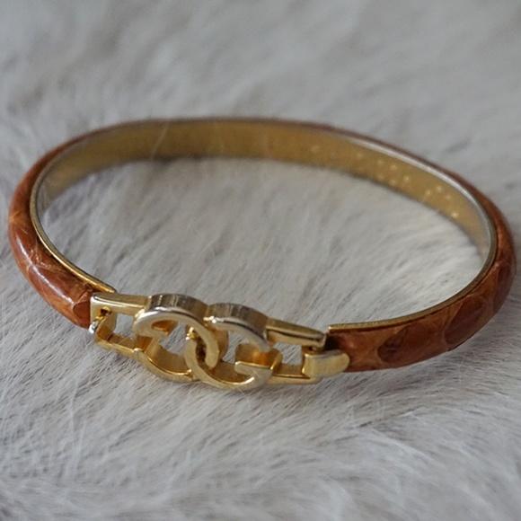 d7b637835ba Gucci Jewelry - Gucci GG Snake Skin 24K Gold Plated Bracelet